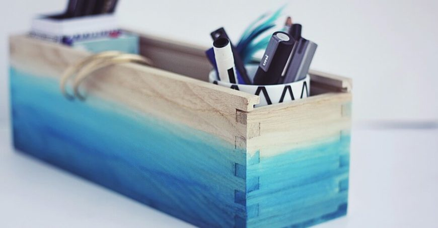 This simple wooden box is dressed up using a simple blue ombre paint job that is inspired by watercolor paintings. It's the perfect spot to store pretty much anything!