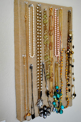 This clever DIY transforms an old shoebox into a jewelry board for hanging your favorite necklaces!