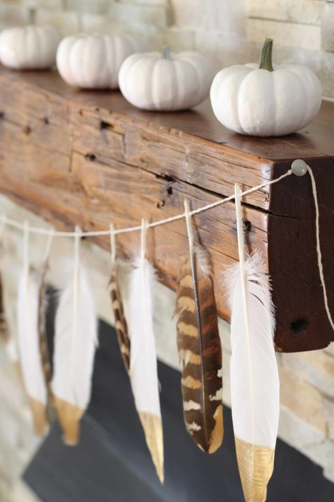 This adorable feather garland would look great hanging on a wall or even across a fireplace. The gold tips are the perfect contrast to the white feathers!