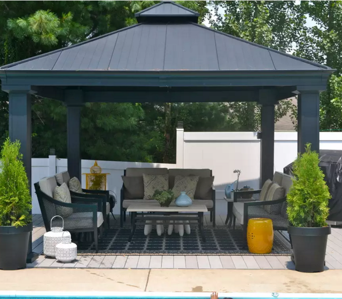 This simple, modern gazebo is the ideal kind of hassle free gazebo perfect for an outside living room extension. With the relaxing set of furniture and rug, it's as though a living room has been transported outside and near the pool.