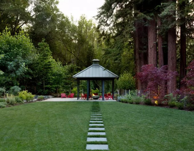 When you have a permanent gazebo you may opt to build elements around it. This gazebo has a great footpath leading to it as well as a warm and welcoming fire pit.