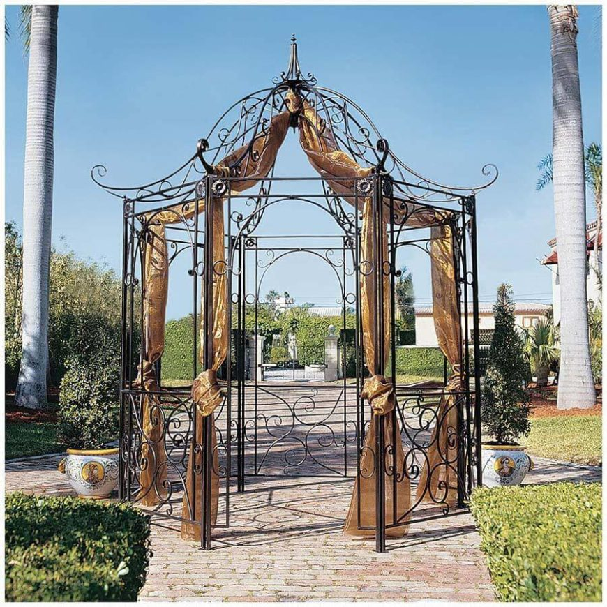 This metal frame gazebo uses its curved and natural lines to build depth and an intrigue that is fun to look at. It is accentuated by hanging curtains that bring color and fullness to the thin and elegant framework.