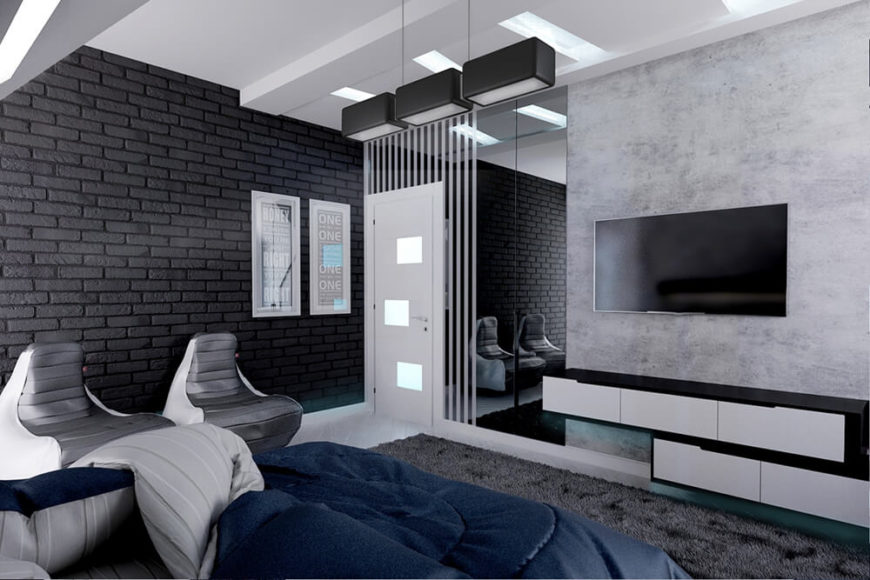 The primary bedroom features black brick walls in contrast to the white marble flooring, with a deep blue bed set for color and contrast.