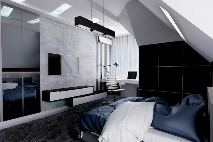 Floating entertainment storage hangs on the wall next to a cozy built-in desk and home office corner. Dark tiles frame the bed area at right.