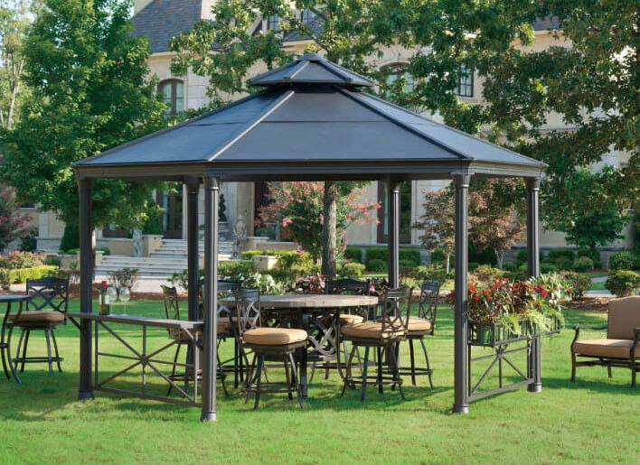 This metal gazebo houses some marvelous hard furniture and a matching center table. Metal gazebos are easy to match with dark metal yard furniture.