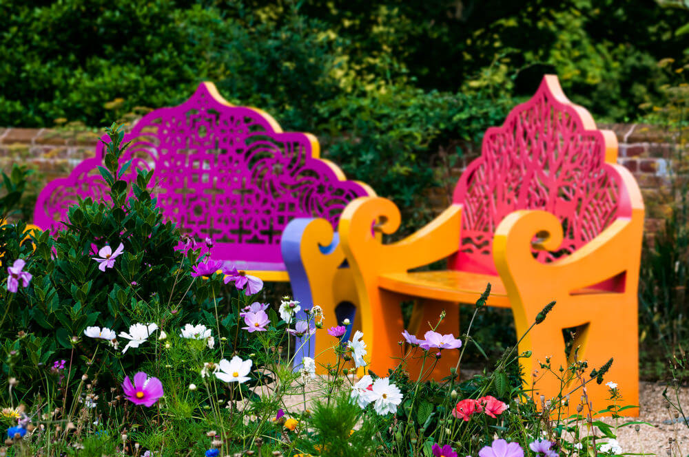 Lively and decorative, these seats are as colorful as the petals of the flowers around them.