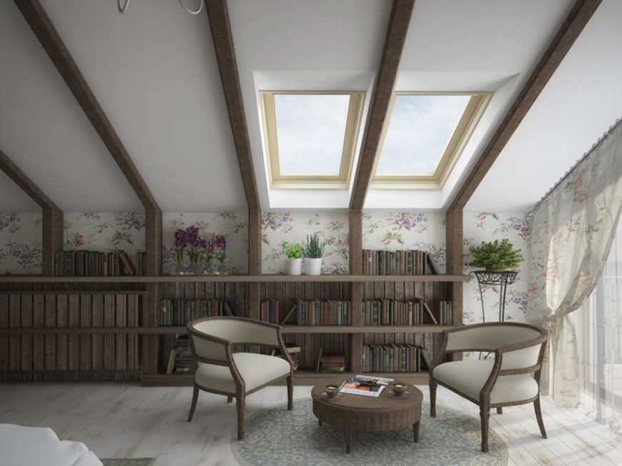 The dark natural wood exposed beams run down the sloped ceiling and help form the framework for the large bookshelves running the length of the room. This helps create the utterly cohesive sense of contrast in this space.
