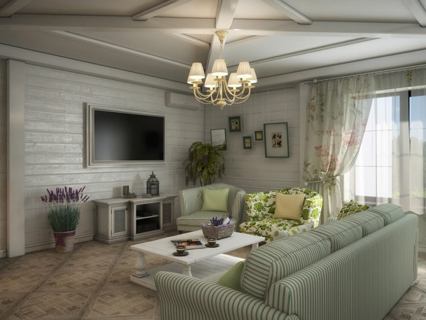 The living room sits beneath a lightly vaulted ceiling with intricately detailed wood beams. The corner is anchored by a white painted wooden feature wall.