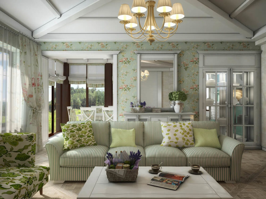 The layout of the home connects this room closely with the dining room and kitchen through a pair of ornate doorways. The molding on both windows and doors is exceptionally detailed.