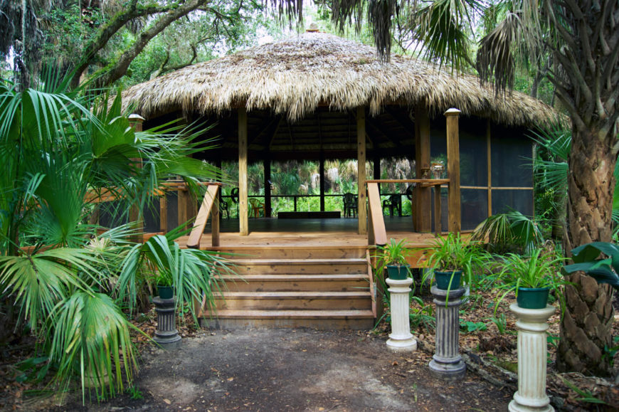 Here is a stylish thatched roof gazebo that is equipped with screens. The space underneath this gazebo is large and can serve to house all kinds of patio furniture as well as host large gatherings.