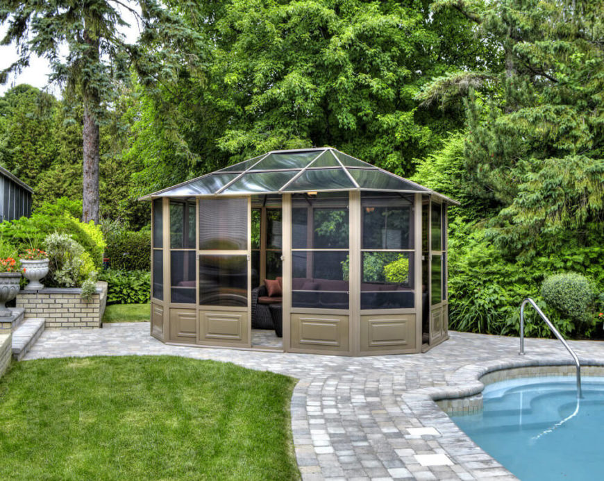 This gazebo is enclosed with windows and screen panels. After a swim in the pool this is the kind of spot that you will be eager to sit back and relax in, without having to worry about the insects.