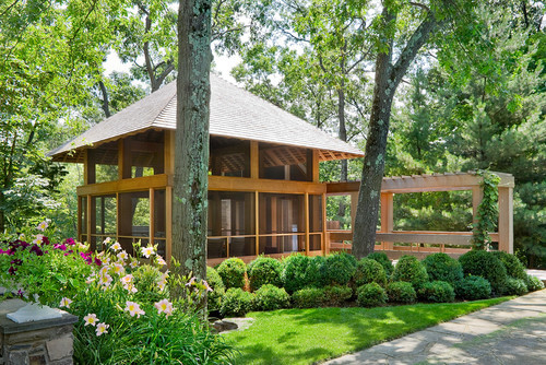 This gazebo with tall ceiling is spacious and has a sturdy construction. The screens keep out pests but allow the people inside to have a full view of the landscape and area around the gazebo.