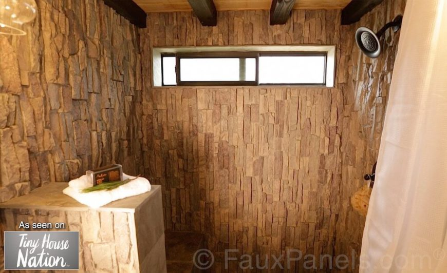 The interior of this shower is tiled in faux stone, which gives it a remarkable texture, much like entering into a cave. This is a perfect addition to a bathroom with a natural atmosphere, or in a rustic home.