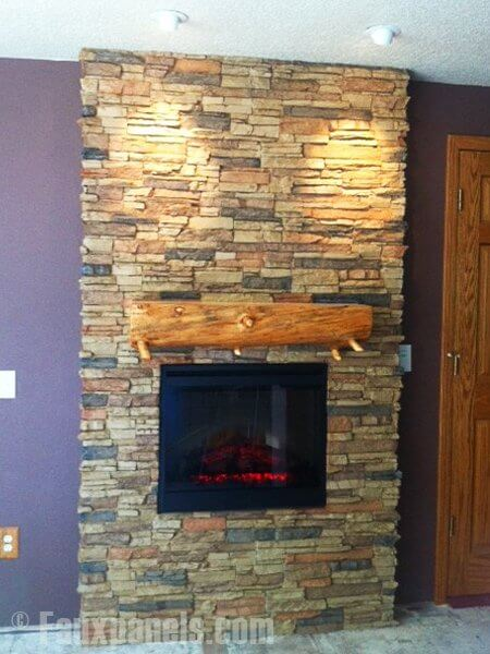 This is another great example of how faux stone can really dress up an otherwise builder's grade or plain fireplace. The addition of a rustic wooden mantel is a great touch.
