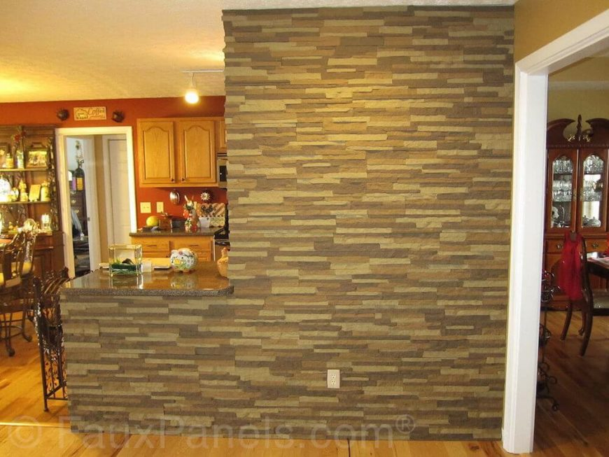 Here, the faux stone is used to create an accent wall leading from the dining room into the kitchen area. It provides contrast and visual interest in an area that would otherwise be fairly plain.