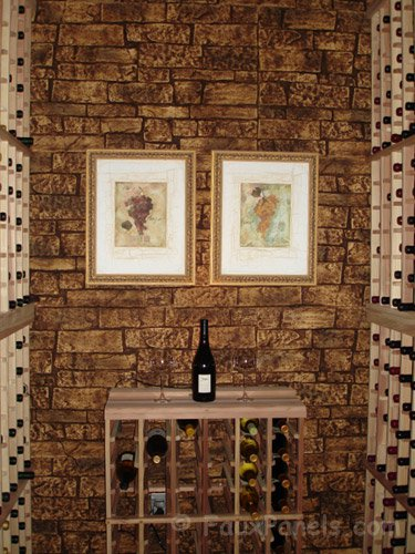 This narrow wine cellar is covered in faux stone paneling, giving the cellar the same atmosphere as underground, expensive wine cellars in Italy.