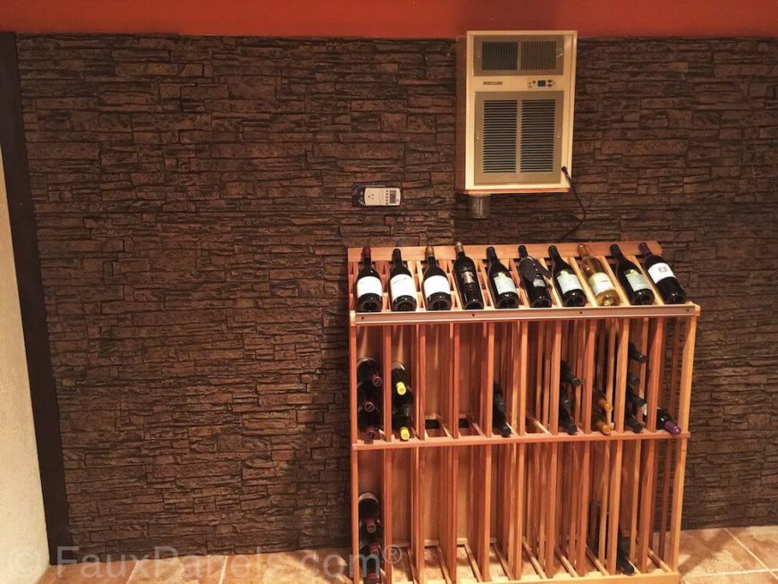 Here's another example of a wine cellar, this time with the faux stone paneling on one wall. It provides contrast to textured walls on either side.