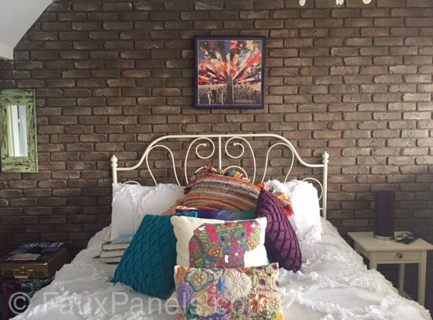 While typically we think of brick, we think of bright red, but dusky brown bricks are an attractive option for the texture you love about brick, but not the bright coloration. Here, it allows the white iron bed frame and colorful pillows to stand out.