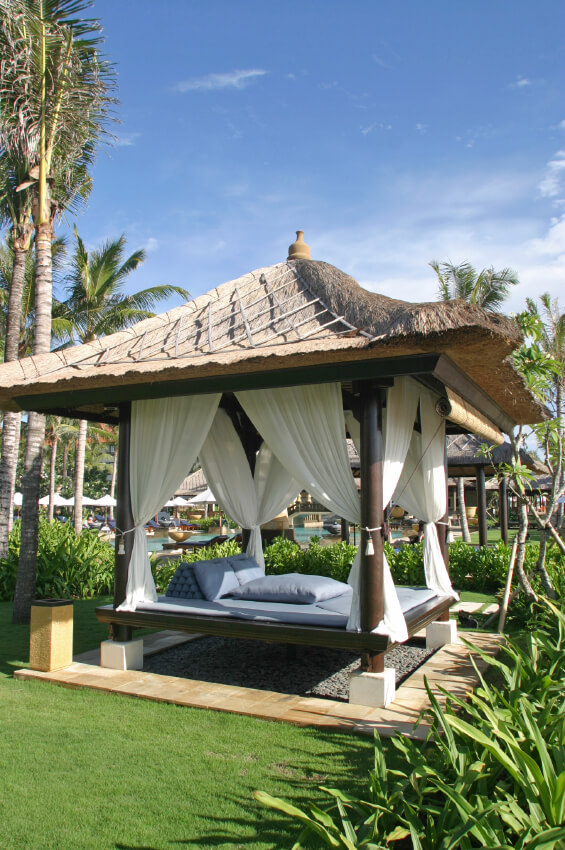 A serene gazebo like this can be a fantastic escape, letting you drift away from your responsibilities. Watch the sun dip below the horizon as you slip away into a relaxing nap.