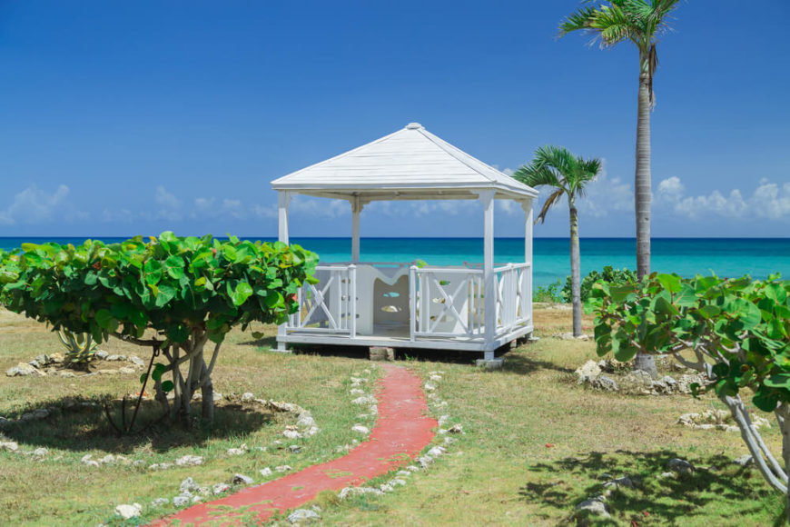 This beachside gazebo is a welcoming and cozy spot to sit and look out over the beach and ocean. On warm days there is no need to sit out in the direct sunlight, you can get some shade under this roof.
