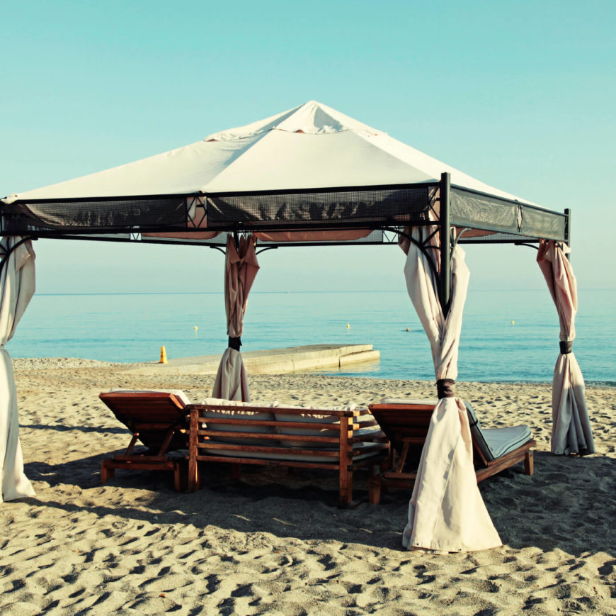 This metal frame gazebo with curtains and a fabric top makes a perfect shady spot to lay back and relax on the beach. Add some comfortable reclining chairs along with the perfect warm day, and your troubles will melt away while the beach consumes you.