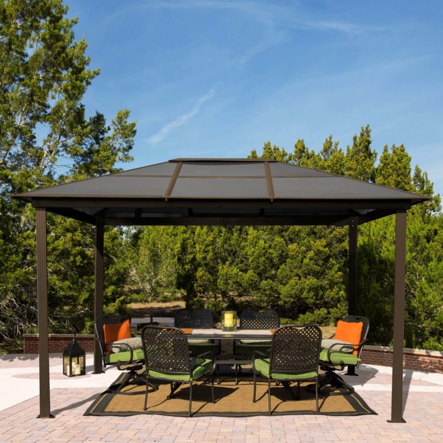 The roof of this gazebo is sleek and simple, as are the posts that hold it up. Shade is provided to space but the gazebo does not make too much of an impact nor take up much room