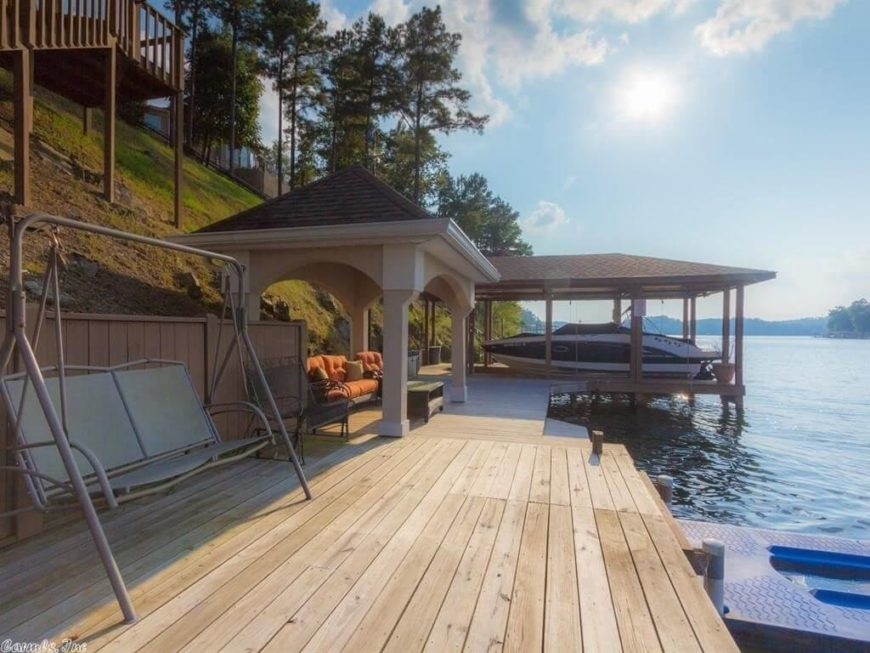 This dock has a gazebo that covers some comfortable outside furniture. You can chill out and watch the boats on the lake while taking in the fresh air.