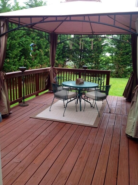 Here is a deck that has a gazebo attached to the structure. You can combine structures like this to save on space and materials. The gazebo becomes a part of the deck and is simply a feature of the space.