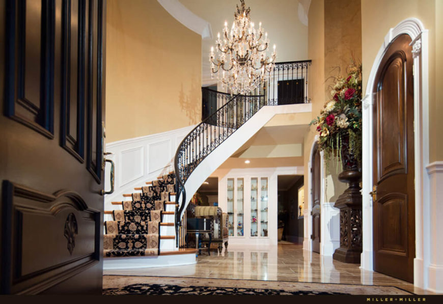 Here's a look into the grand foyer, wrapped in elegant details and giving an expansive look into the home.