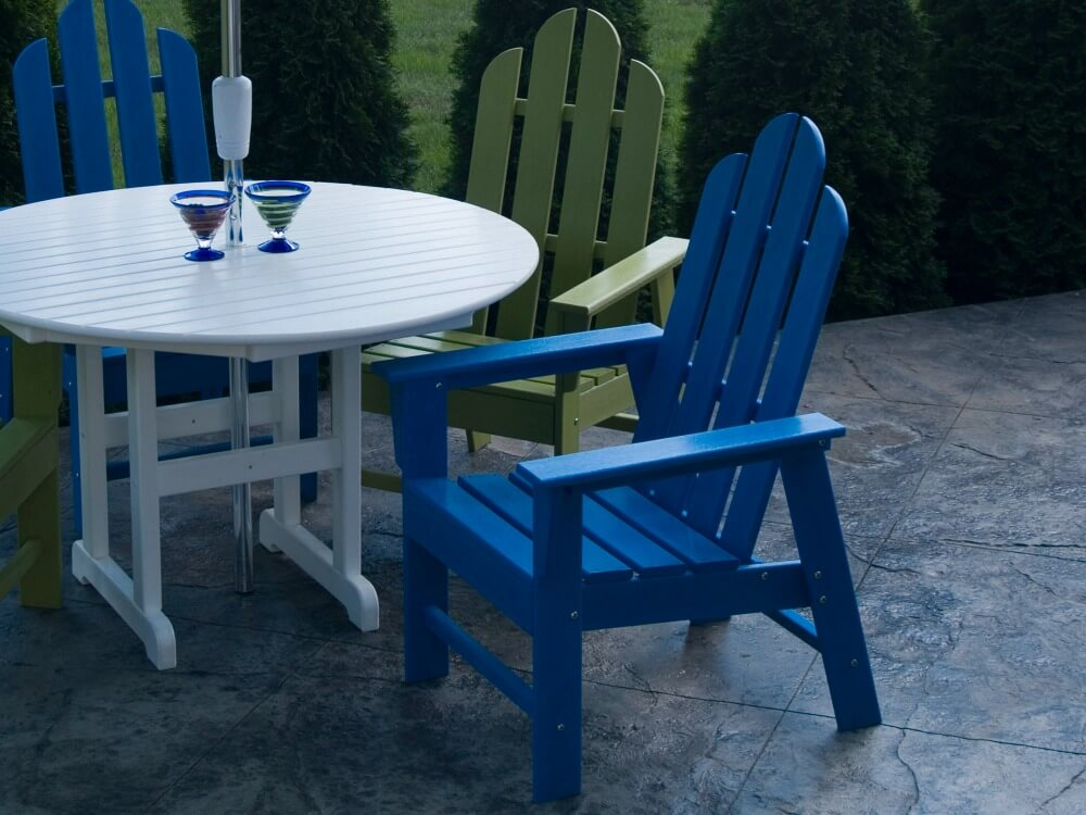 Patio dining set with white table and blue wood chairs