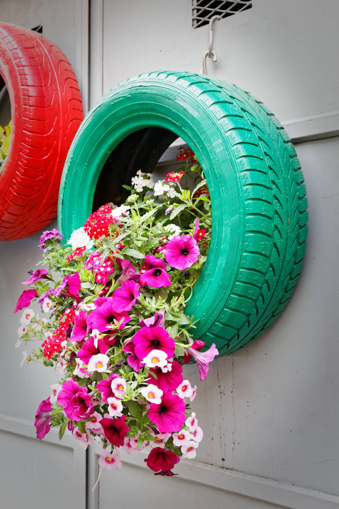 Isn't that cool? I love this particular tire planter with flowers pouring out of it hanging on a door.