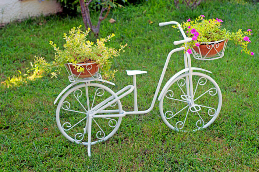 Here's a decorative white bicycle planter.
