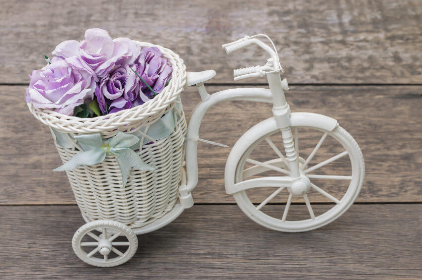 A cute all-white tricycle flower holder.
