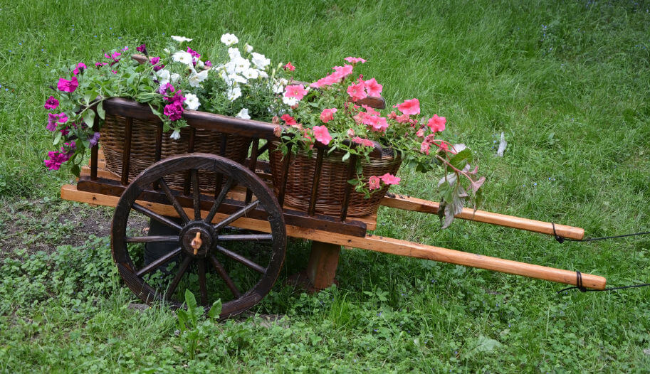 All wood wheelbarrow planter with wood wheel.