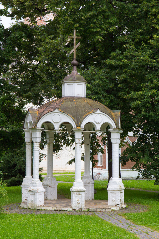 This gazebo has a fabulous patina that gives this space a historical and aged look. A round gazebo like this works well on a path.