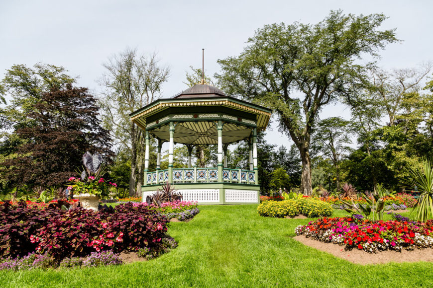 This gazebo sits in the center of flower gardens, making it a splendid spot to sit and look at the blossoms. The colors of the gazebo match the colors of the gardens well.