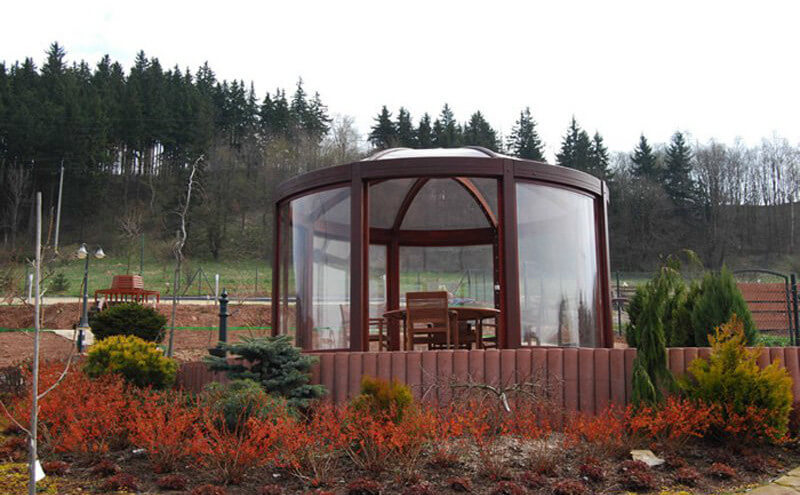 This gazebo has large glass panels and a glass dome as a roof. This unique and interesting design gives you a wide range of view while also offering maximum protection from the weather.
