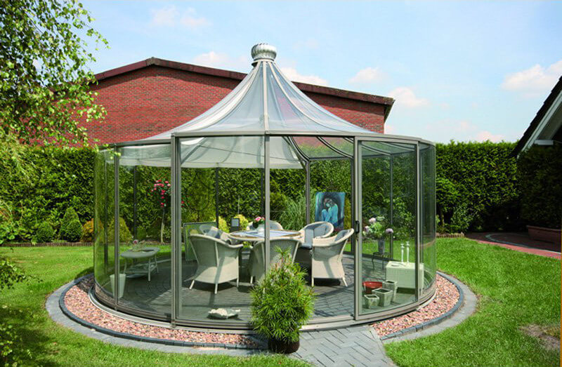 This round gazebo is encased in glass with a peaked top. The gazebo has a glass bottle look that is unique and interesting. It can introduce a fun and appealing dynamic to your space.