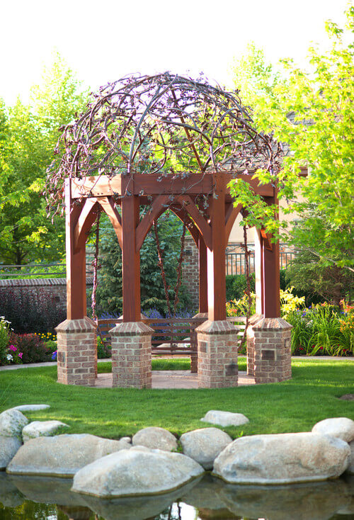 Some round gazebos have mesh or wire frame ceilings rather than the typical roof. These types of ceilings are perfect for covering in crawling plants and vines.