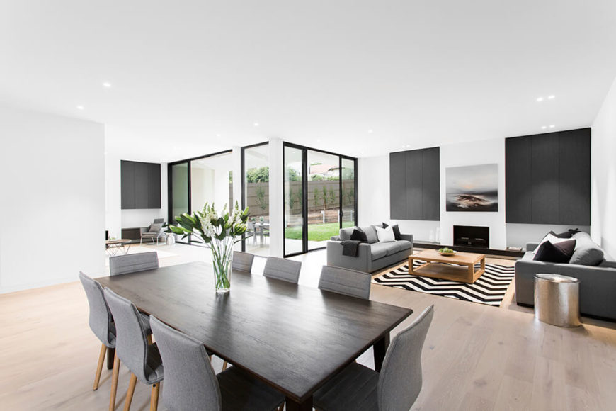 The main portion of the home interior is this large open plan space, mixing social, dining, and kitchen functions. To the righ twe see the formal living room, and to the left a cozier relaxing space.