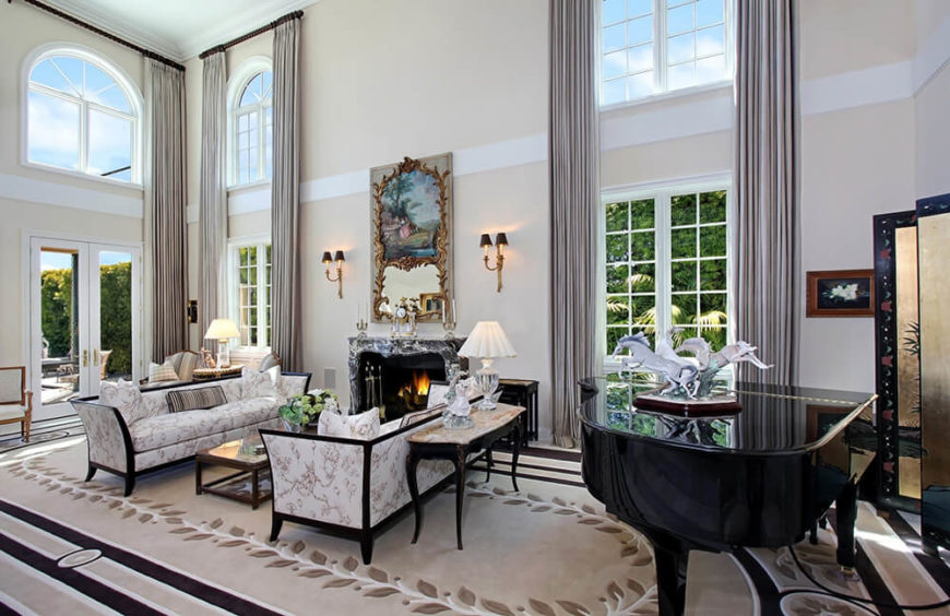 This room is furnished with a couple of matching and stylish cabriole style sofas. The light pattern and the contrasting wood work create a lovely dramatic design to a couple of elegant and welcoming sofas.