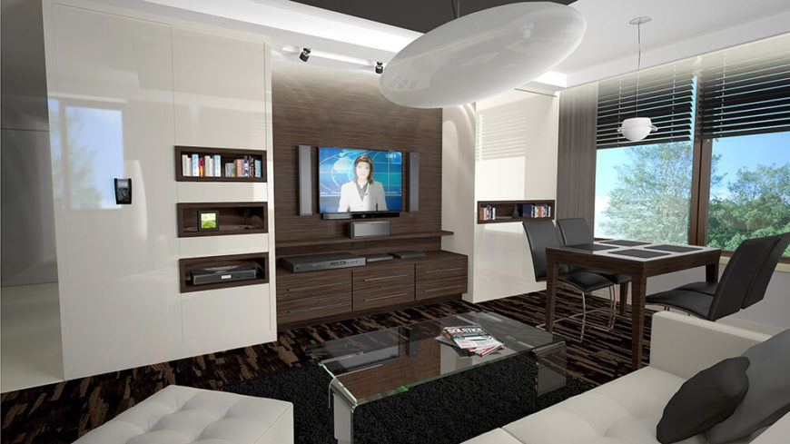 This modern living room is furnished with sleek and modern sofas that are customized to fit perfectly into this space.