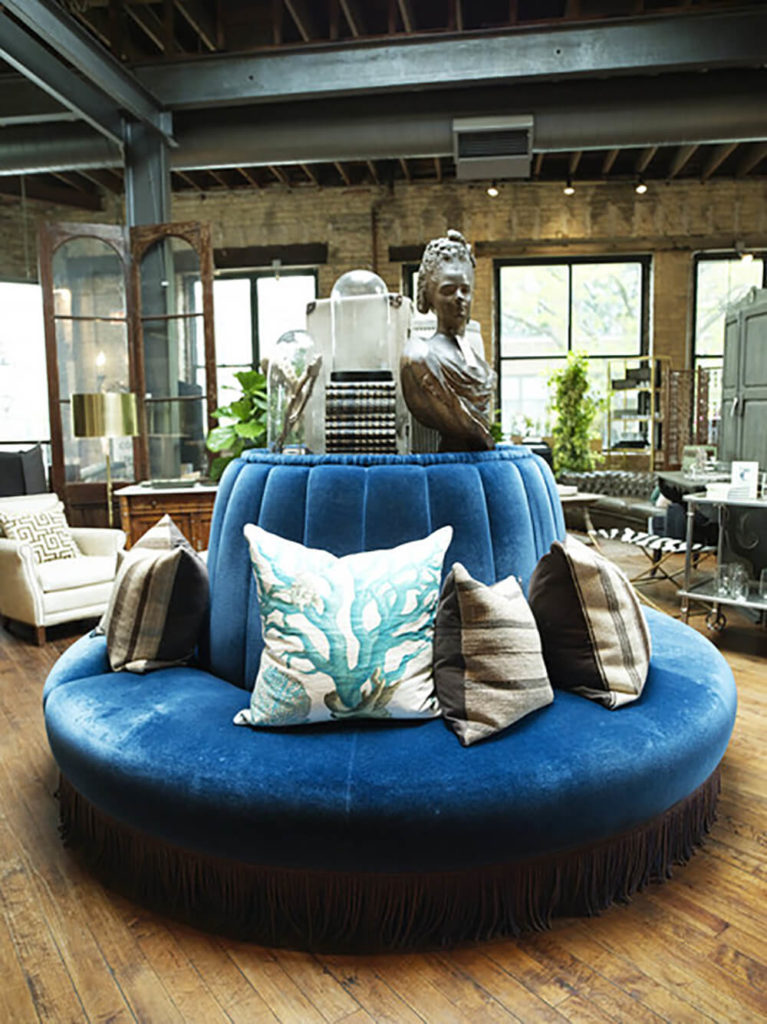 Round sofas often have centers that can be used as shelf space. This space can hold all kinds of items staged here which adds to the design and style.