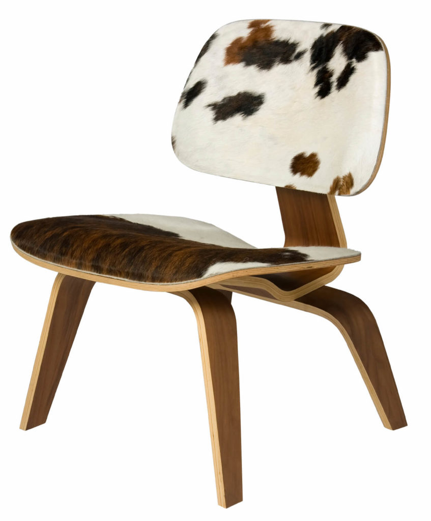 Not all LCW chairs have a light wood finish. This one has an animal print pattern pressed into the wood. This stylish finish gives this chair new life and the ability to be matched with different styles in various ways.