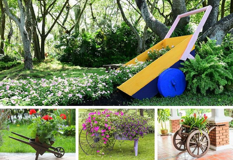 4 wheel barrow planters in gardens