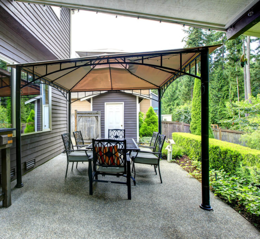 This gazebo with a stylish flair sets a great stage for a patio seating area that will make your guests feel at home.