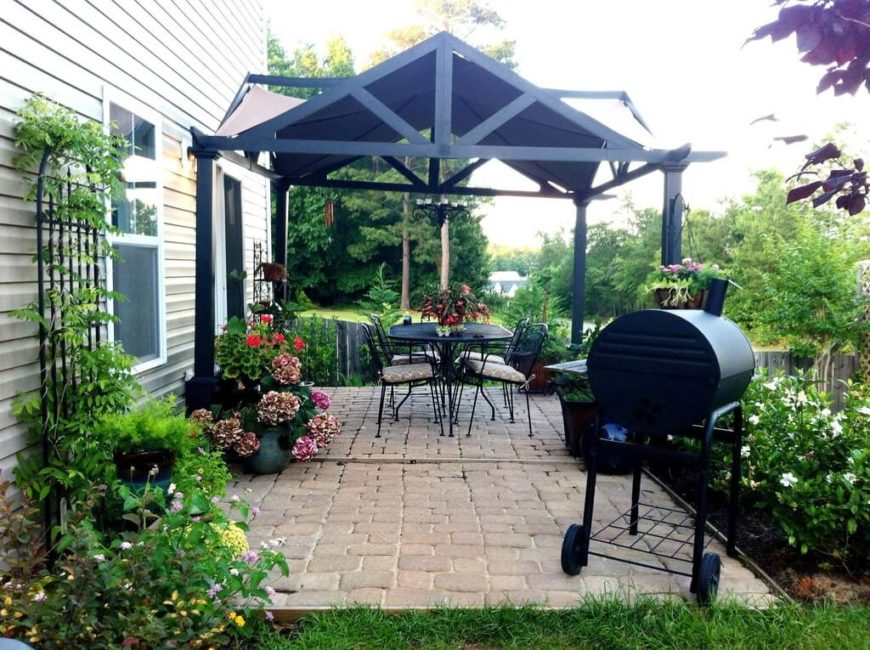 This interesting gazebo has a roof design that is not like many others. The roof design draws attention and adds great design elements to the patio space.