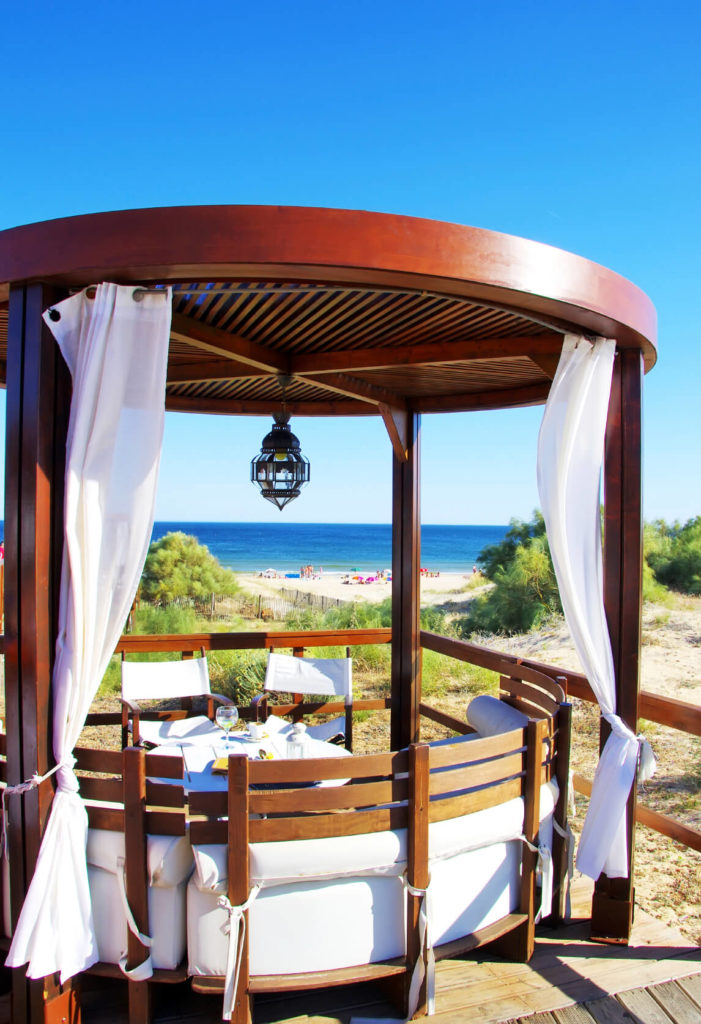 A romantic pergola-patio combo overlooking the beautiful beach and sea.
