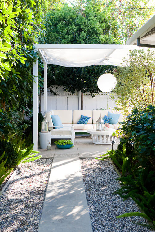 This simple gazebo has a breezy and elegant feel. The simple posts and light, white draped cloth top brings along an easy and comforting feel that is welcoming and warm.