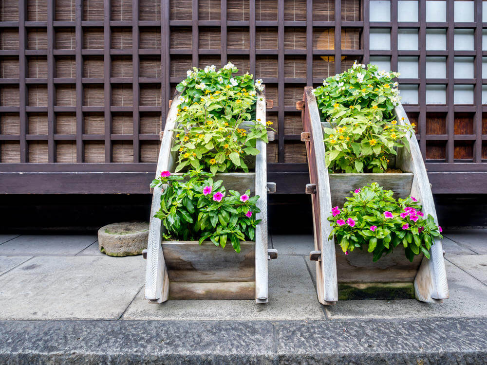 Clever custom wood planters creating a tired wooden planter.